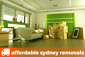 a room with a lounge, picture frame and removalist boxes waiting to be collected by a removalist